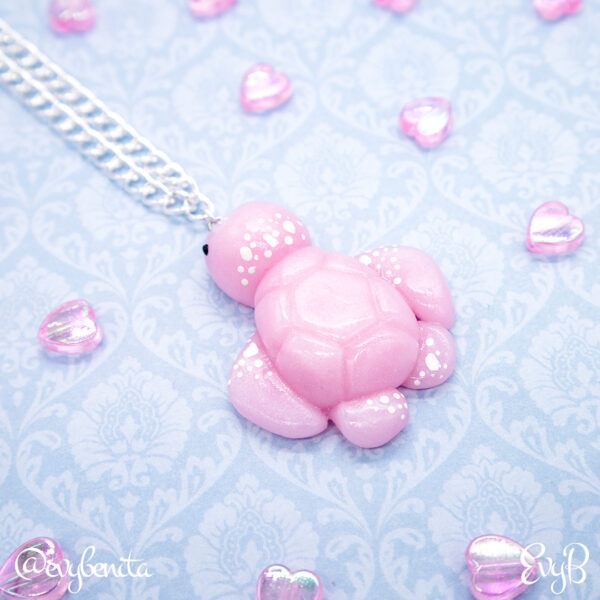 Shimmering pastel pink sea turtle charm made from Fimo Rose Quartz polymer clay. Charms by EvyB.