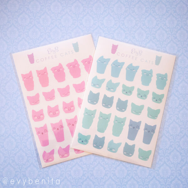 Two sheets stickers depicting travel mug-shapes with cat ears and kawaii cat faces. One sheet shows the pink color variant, the other shows the teal color variant. Perfect for planning early morning work hours or school sessions.