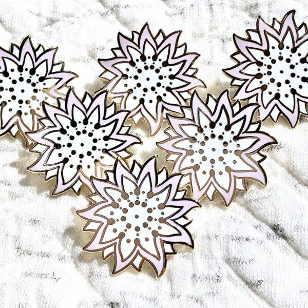 Gold plated sunflower starfish hard enamel pins by Evy Benita