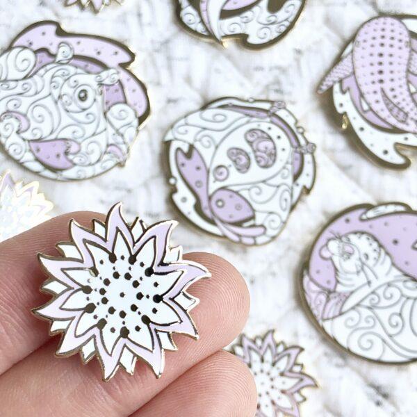 Gold plated sunflower starfish hard enamel pin by Evy Benita