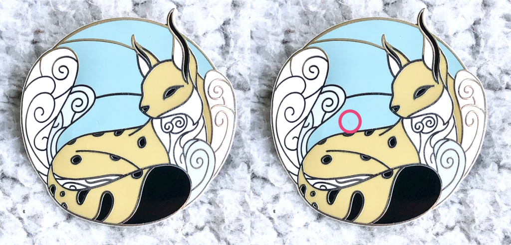 A winter landscape enamel pin by EvyB, depicting a tranquil lynx resting in a winter setting. The lynx's warm yellow gives a beautiful contrast to the cold blue and white background.