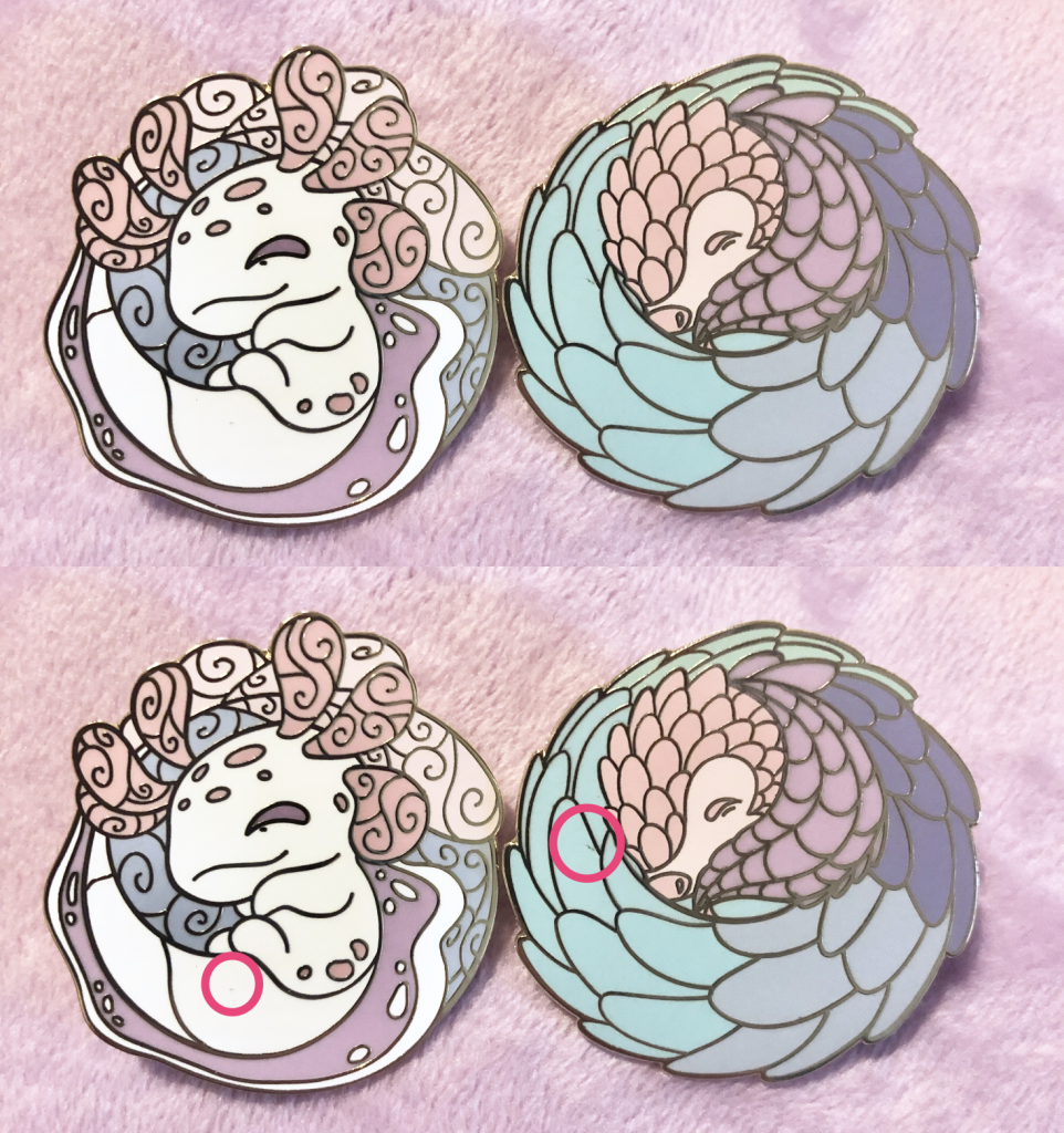 An axolotl enamel pin with a small piece of dust embedded in its white paint, and a rainbow pangolin hard enamel pin with a dark scratch on one of its blue paint scales.