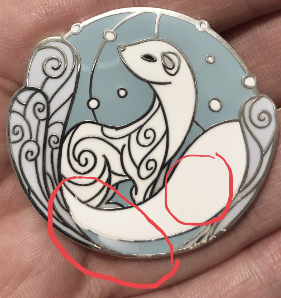 "A ""Salvage Grade"" hard enamel pin depicting a tranquil snow mink. The pin has a smudge of white paint going over the metal plating and into the blue background area."
