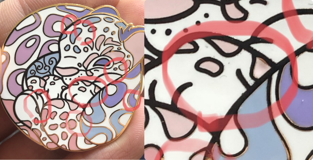 Minor defects are highlighted in one of my Clouded Leopard enamel pins.