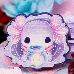 A 1-inch cartoon style wooden pin featuring Lottie the Lotl holding a glass bowl with a little flame friend inside.