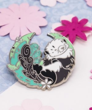 Seaweed sea otter enamel pin by Evy Benita.