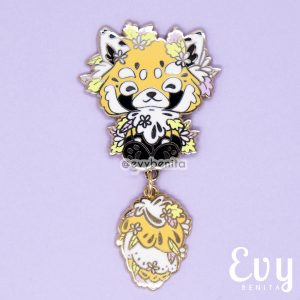 A red panda enamel pin with outlines in raised gold metal and a dangling tail.