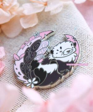 A lapel pin featuring a cute sea otter.