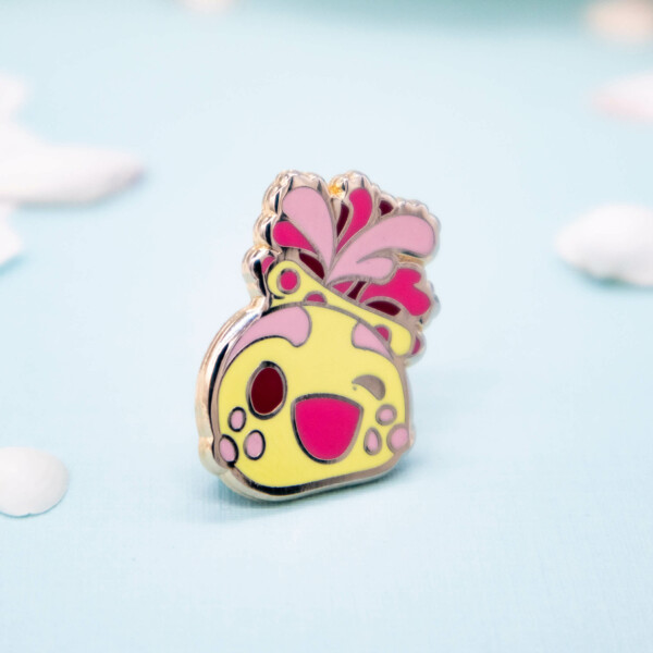 Cute gold plated chibi sea apple enamel pin by Evy Benita