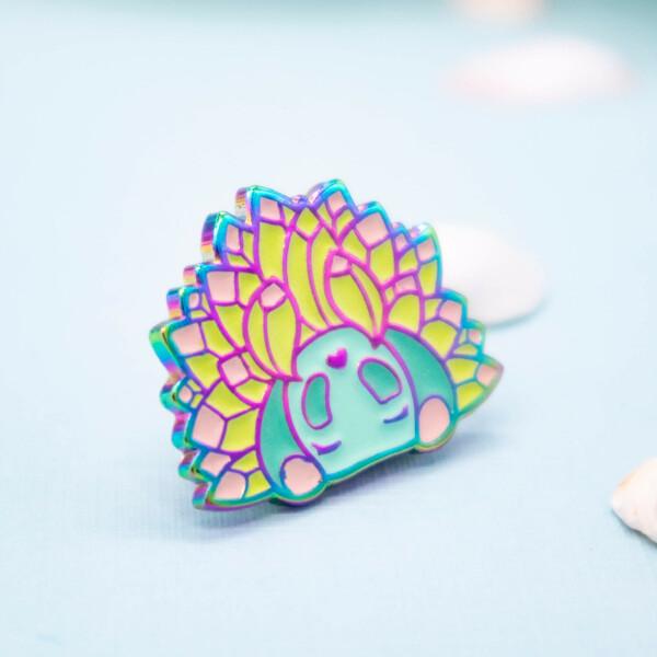 "Costasiella Kuroshimae ""sea sheep"" enamel pin with anodized rainbow plating. By Evy Benita."