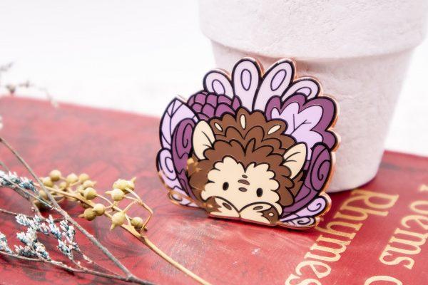 Rose gold-plated hedgehog enamel pin