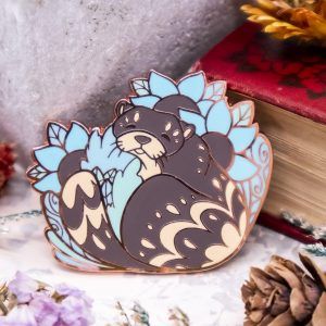 Rose gold-plated river otter enamel pin