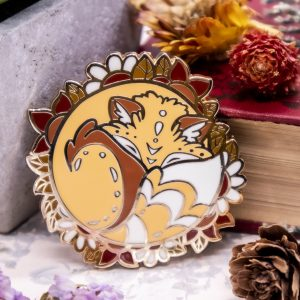 Sleepy red fox enamel pin