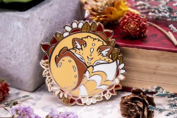 Sleepy red fox enamel pin