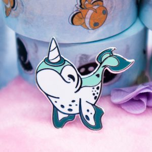 Teal narwhal enamel pin with silver plating.