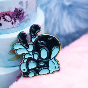 A Nembrotha Cristata nudibranch enamel pin in rainbow metal.