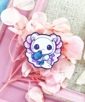 "An adorable axolotl wooden pin featuring Evy Benita's ""Lottie the Lotl"" dressed up as a polar bear."