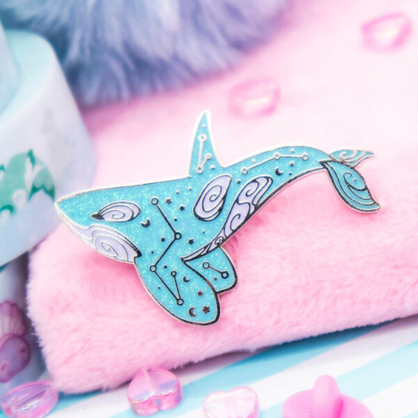 Bubblegum blue orca enamel pin. Made with super sparkly iridescent glitter and silver plated metal.