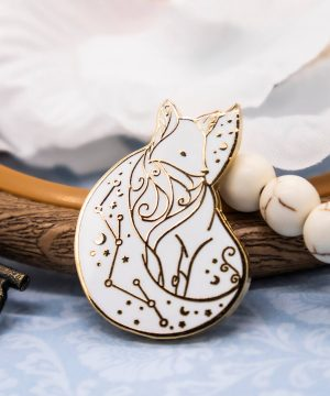 Arctic fox enamel pin with gold plating. Designed by Evy Benita.
