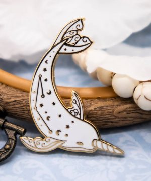 Beautiful narwhal enamel pin with gold plating. Designed by Evy Benita.