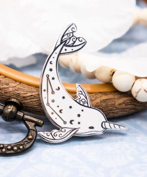 Arctic narwhale enamel pin with icy silver plating. Designed by Evy Benita.