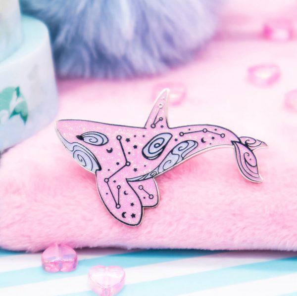Bubblegum pink orca enamel pin. Made with super sparkly iridescent glitter and silver plated metal.