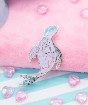 Bubblegum blue leopard seal enamel pin. Made with super sparkly iridescent glitter and silver plated metal.