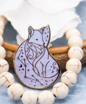 Arctic fox enamel pin with iridescent glitter. Designed by Evy Benita.