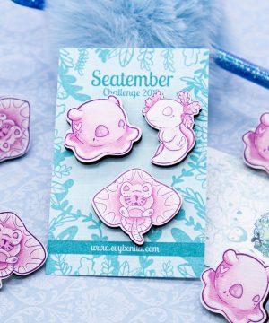 Cute pink set of illustrated chibi sea creature pin badges by Evy Benita