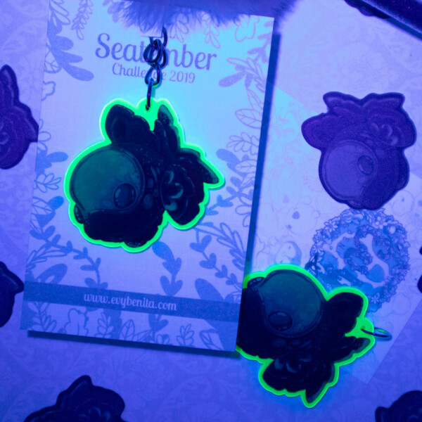 Cute deep-sea fish acrylic keychain charm that glows under fluorescent light!