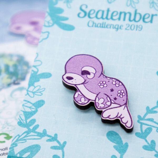 Purple seal wooden pin badge by Evy Benita