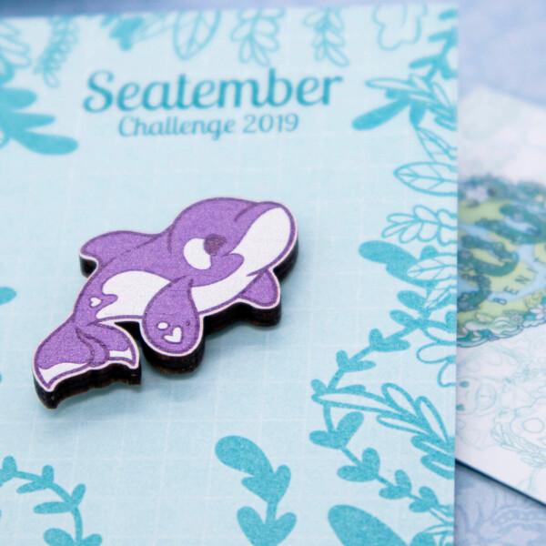 Cute orca wooden pin badge by Evy Benita