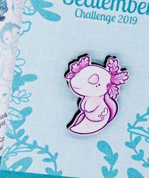 Cute illustrated axolotl pin badge by Evy Benita