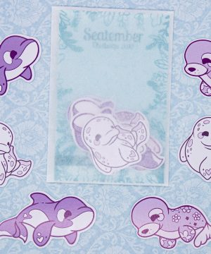 Cute illustrated sticker pack by Evy Benita, featuring six stickers of three purple-themed sea creatures: a beluga whale, a ringed seal, and an orca/killer whale.