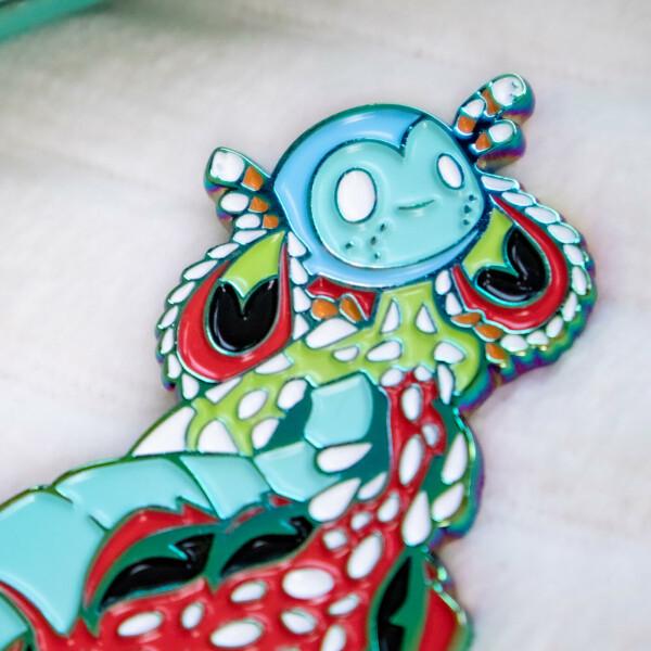 Colorful Peacock Mantis Shrimp mermaid enamel pin doll with beautiful rainbow metal plating. - By Evy Benita