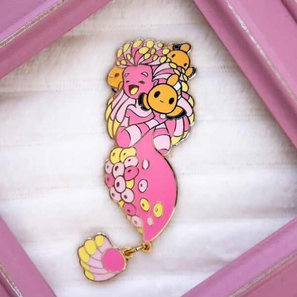 A Sea Anemone Mermaid enamel pin doll by Evy Benita - part of the Mermaids of the Earth universe
