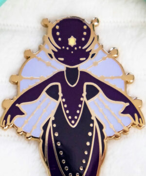 """A dangle-tail enamel pin featuring Evy Benita's """"Deep-Sea Anglerfish Mermaid"""" species from the Mermaids of the Earth Universe"""