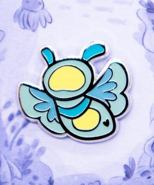 Glow-in-the-dark blue sea angel enamel pin designed by Evy Benita