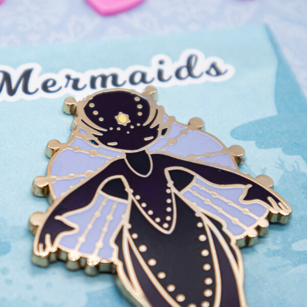"A dangle-tail enamel pin featuring Evy Benita's ""Deep-Sea Anglerfish Mermaid"" species from the Mermaids of the Earth Universe"
