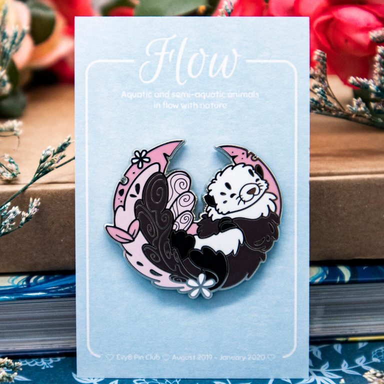 A lapel pin featuring a cute sea otter.