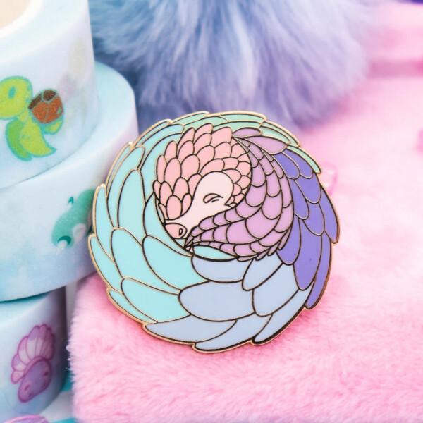 Cute pastel pangolin hard enamel pin by Evy Benita