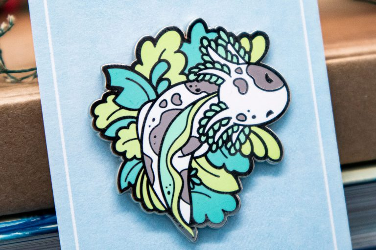 Cute speckled axolotl lapel pin.
