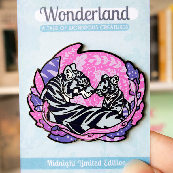 An enamel pin in a semi-realistic style, but non-realistic colors, featuring two tigers (parent and cub) facing each other in a sweet and peaceful setting.