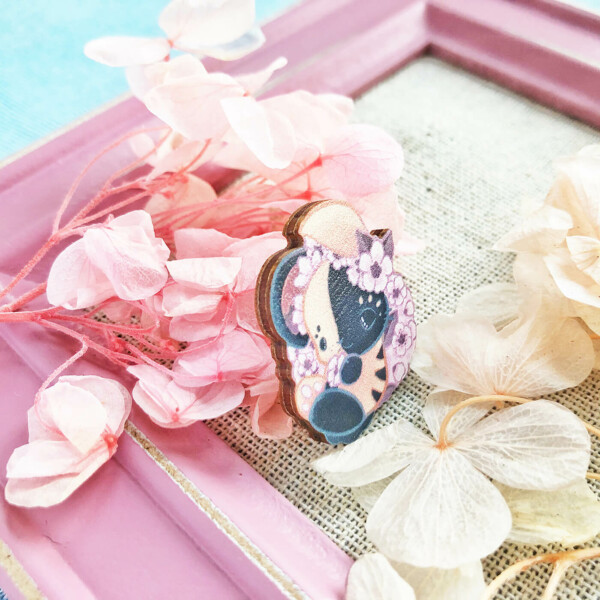 An illustrated wooden pin showing a cute Japanese bunny surrounded by cherry blossoms! The pin stands slanted to the side in order to show off its thickness: roughly 2mm.