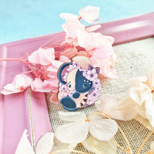 Japanese bunny pin badge decorated by illustrated sakura blossoms. Illustrated by Evy Benita, and made in the UK with sustainably sourced wood.