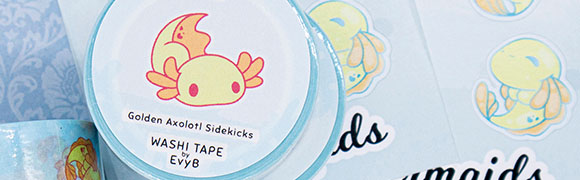 """Washi tape featuring yellow """"golden"""" axolotls in an adorable cartoon art style. Illustrated by Evy Benita."""