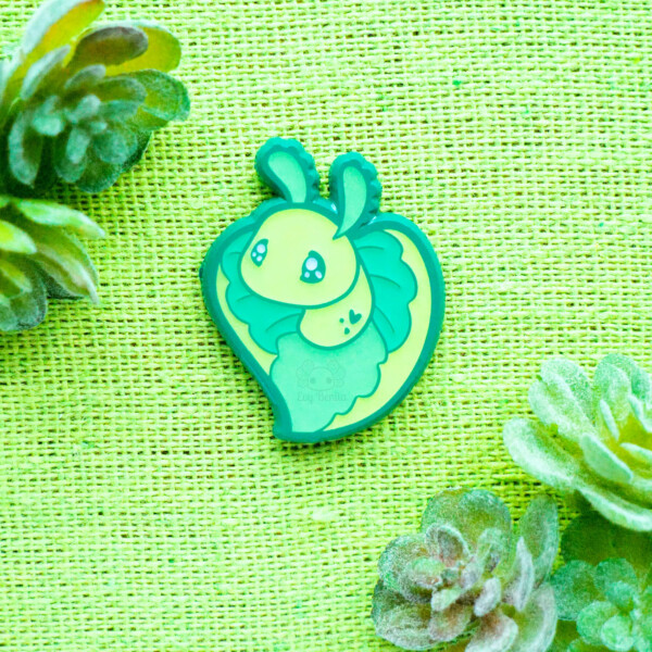 Heart-Shaped Emerald Elysia sea slug enamel pin by Evy Benita. Made with ridiculously vibrant green enamel and plating.