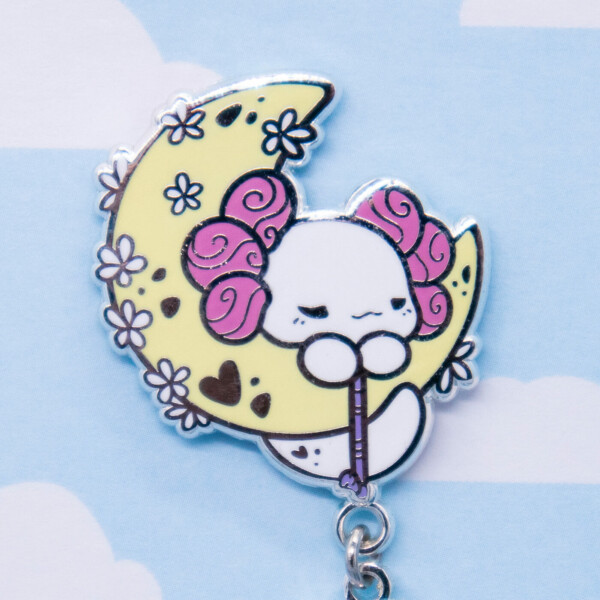 Evy Benita's Lottie the Lotl Crescent Moon enamel pin with dangle charm.