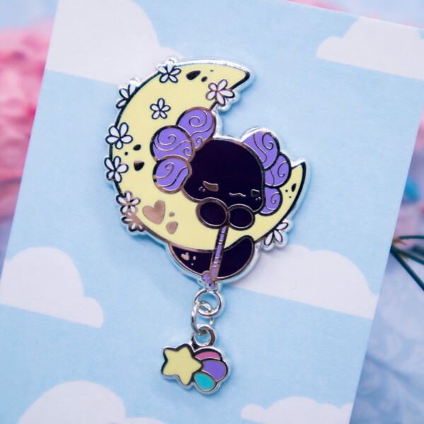 "Luna the Lotl ""Moon Blossom"" hard enamel pin with a shooting star dangle charm. By Evy Benita."