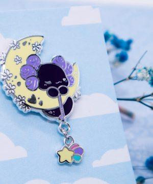 "Luna the Lotl ""Moon Blossom"" hard enamel pin with a shooting star dangle charm. By Evy Benita."